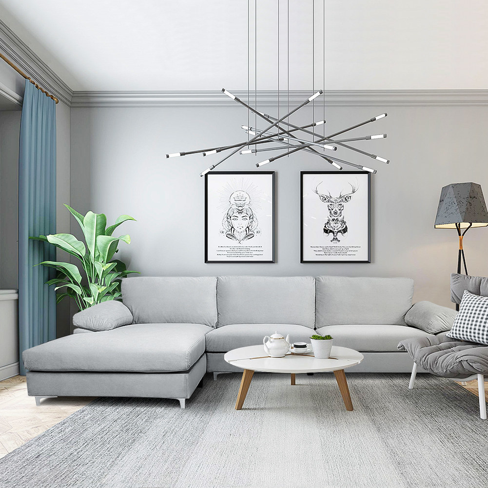 Gray sectional couch with short light legs