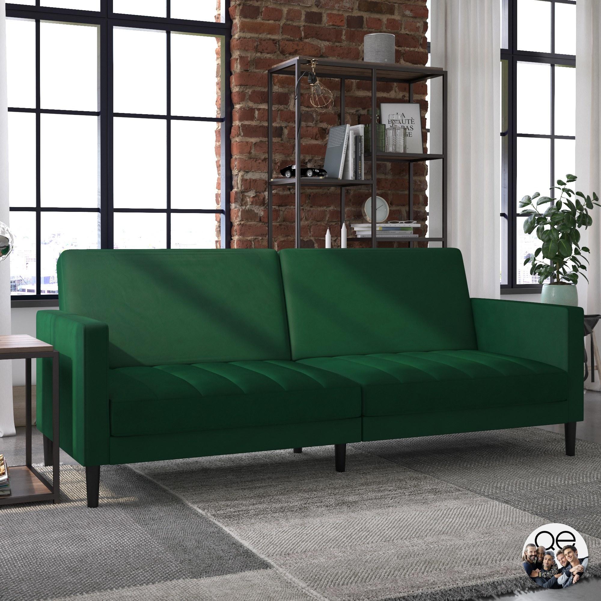Green velvet sofa with dark wooden legs