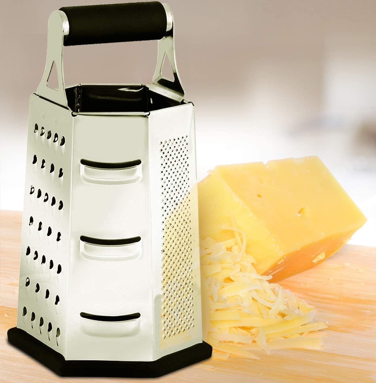 A hexagonal box grater beside grated cheese