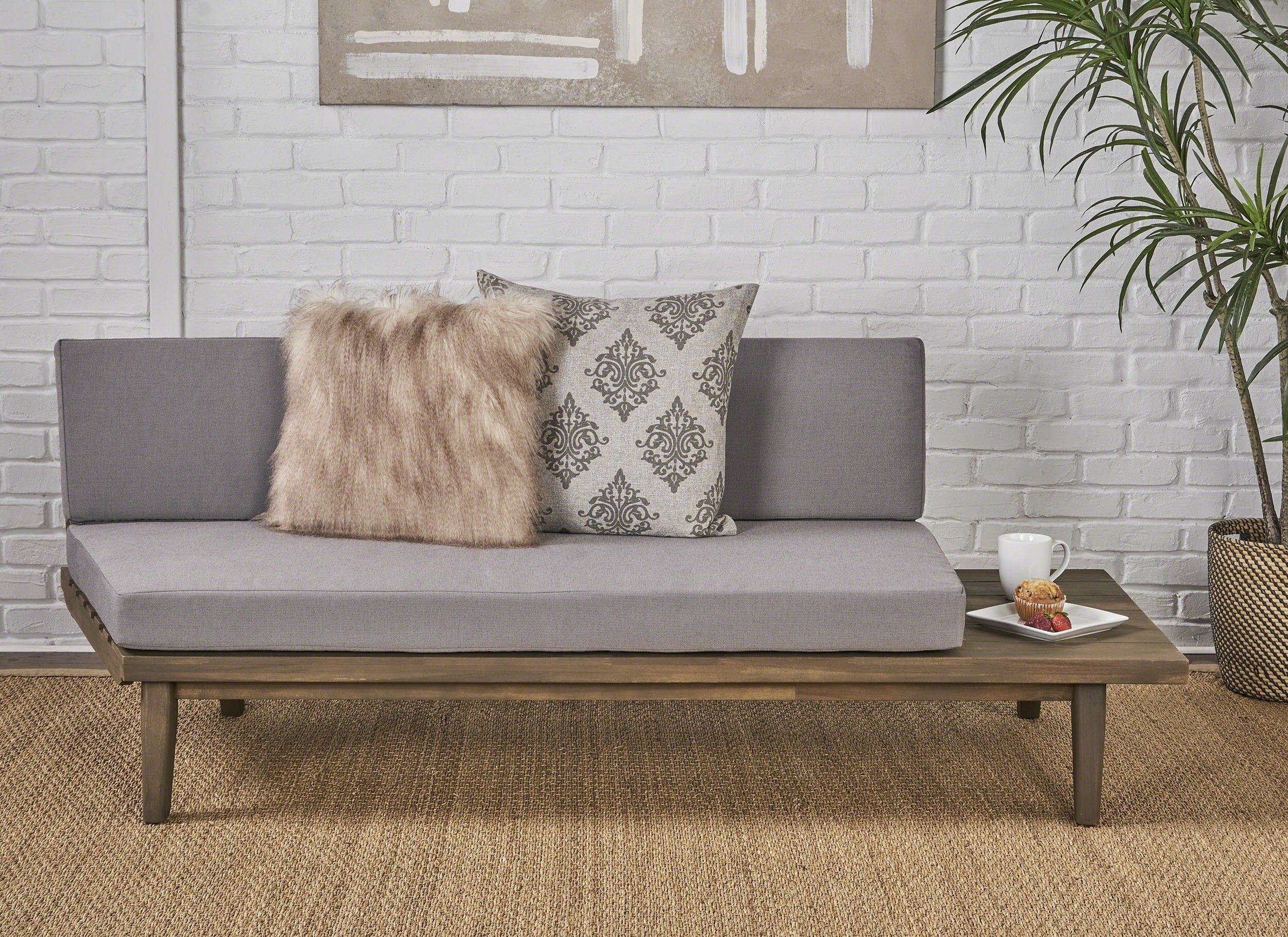 Gray minimalist couch with wooden frame and built-in side table