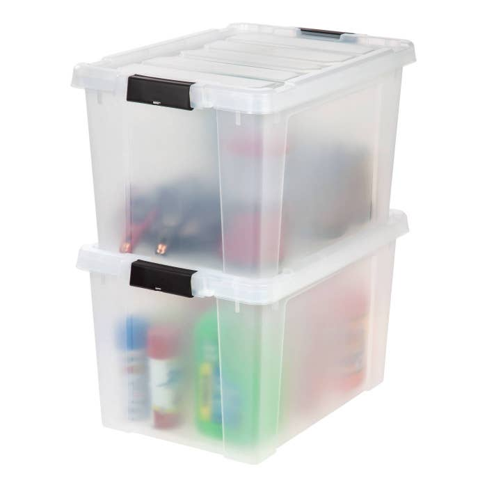 Two clear plastic bins with miscellaneous items inside
