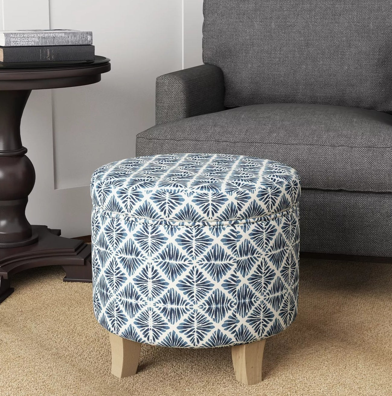 A blue diamond-patterned storage ottoman
