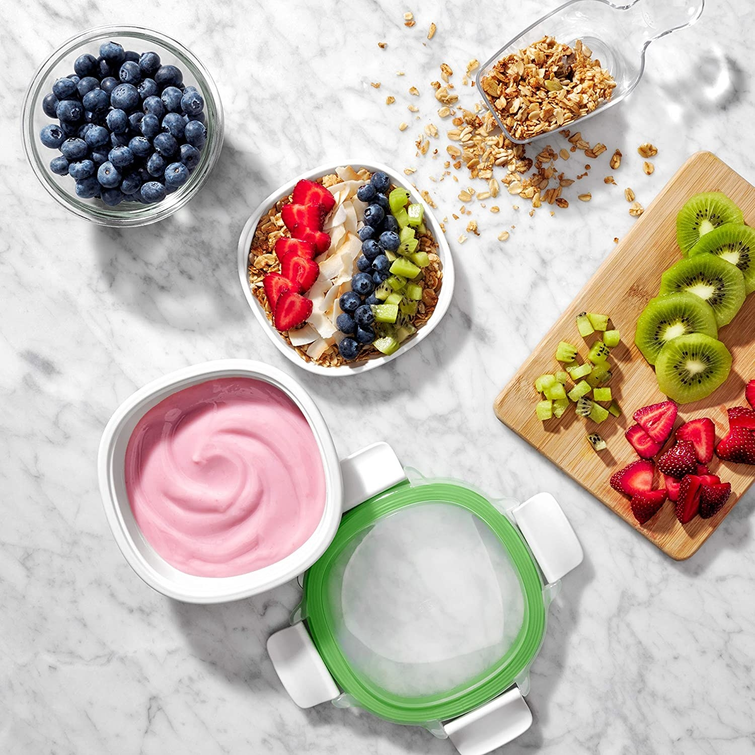 A flatlay of the stackable box containing fruit and yogurt in separate compartments