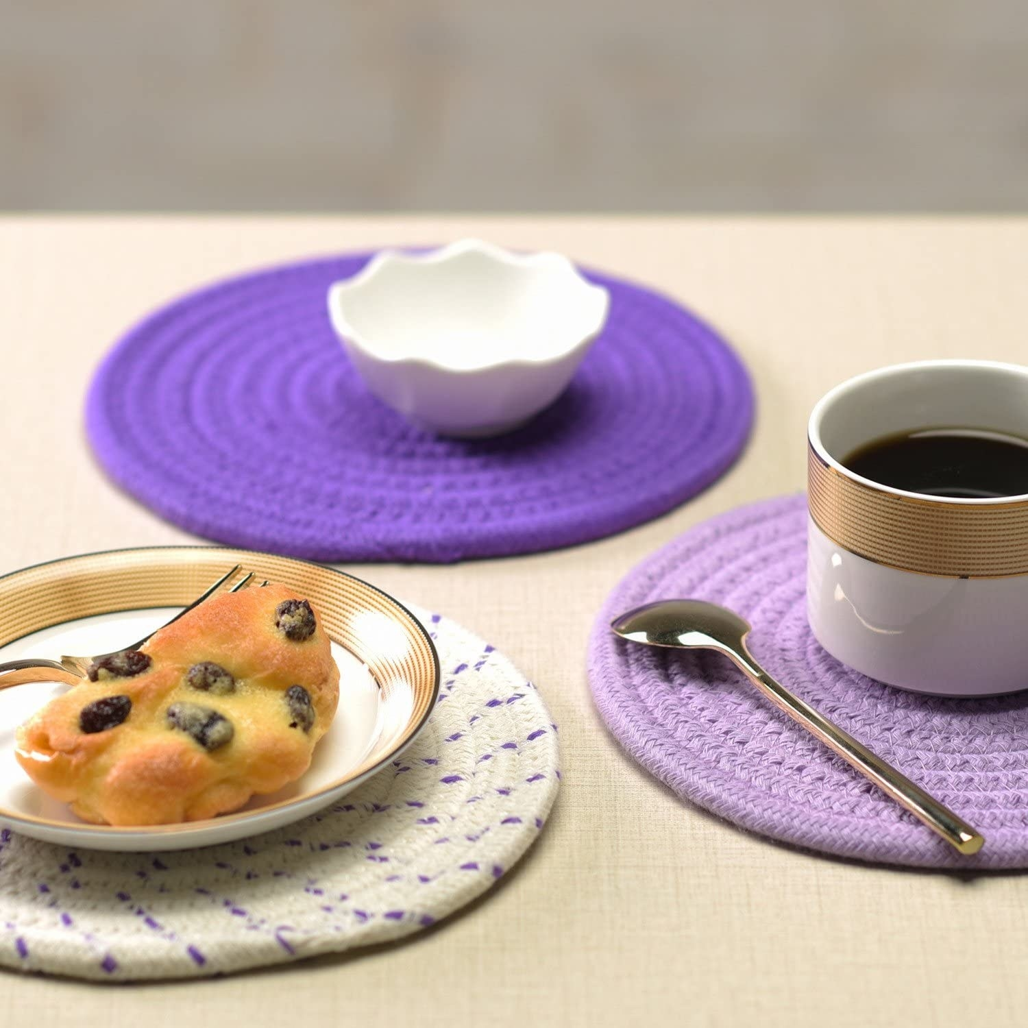 A trio of trivets under a coffee cup and a dessert plate