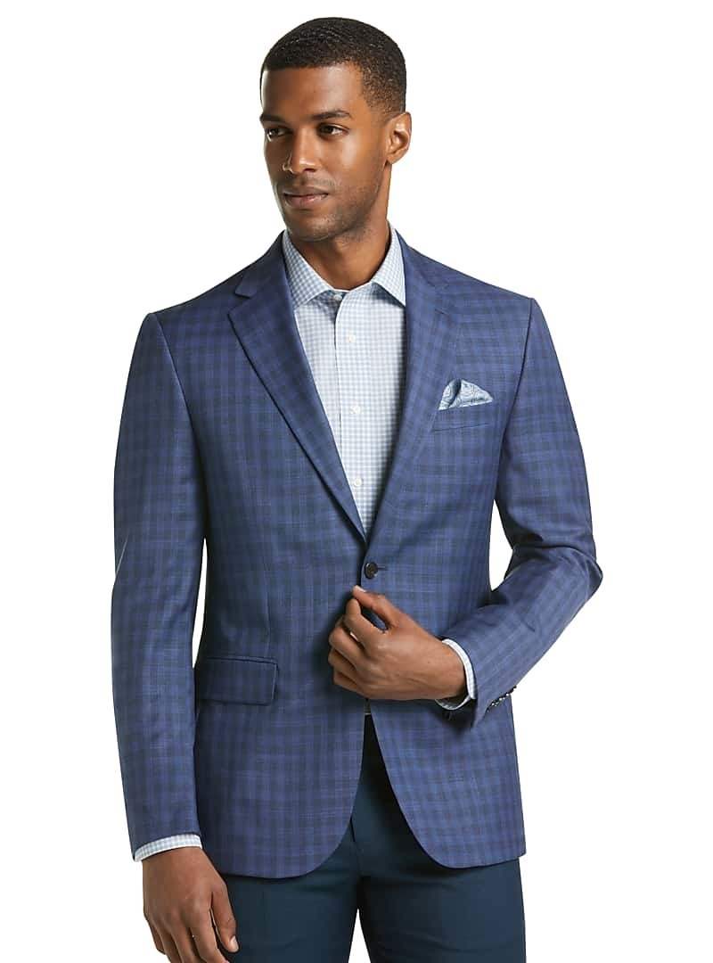 Model wearing Traveler Collection check sportcoat in blue