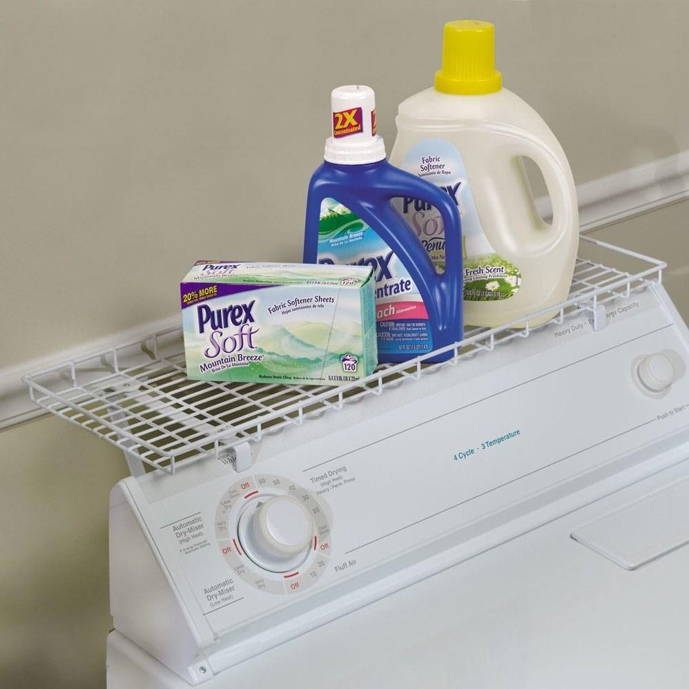 White wire shelving above a washing machine