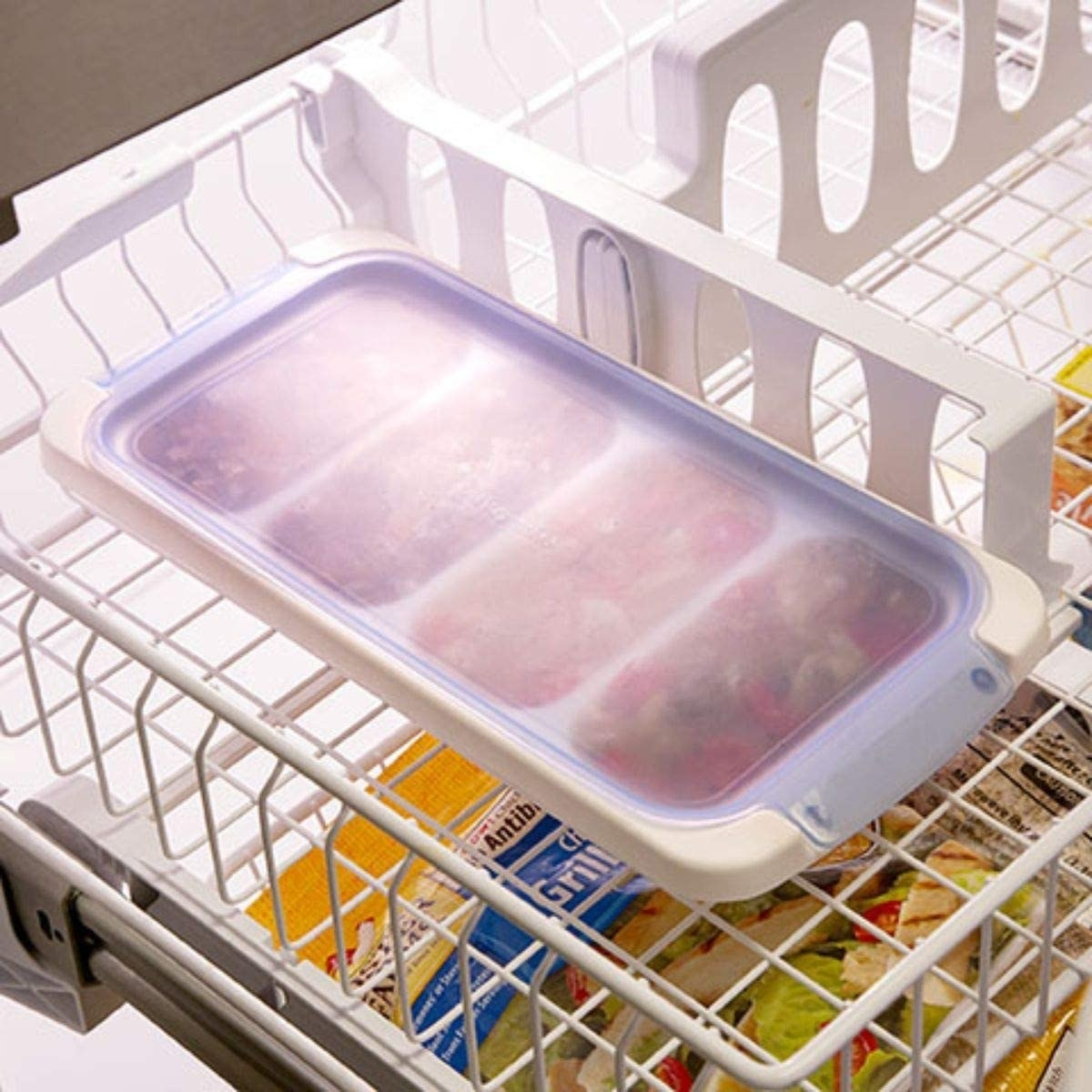 The tray in a freezer with soup stored inside