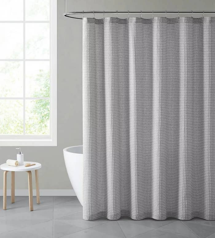 A gray, waffle-weave shower curtain