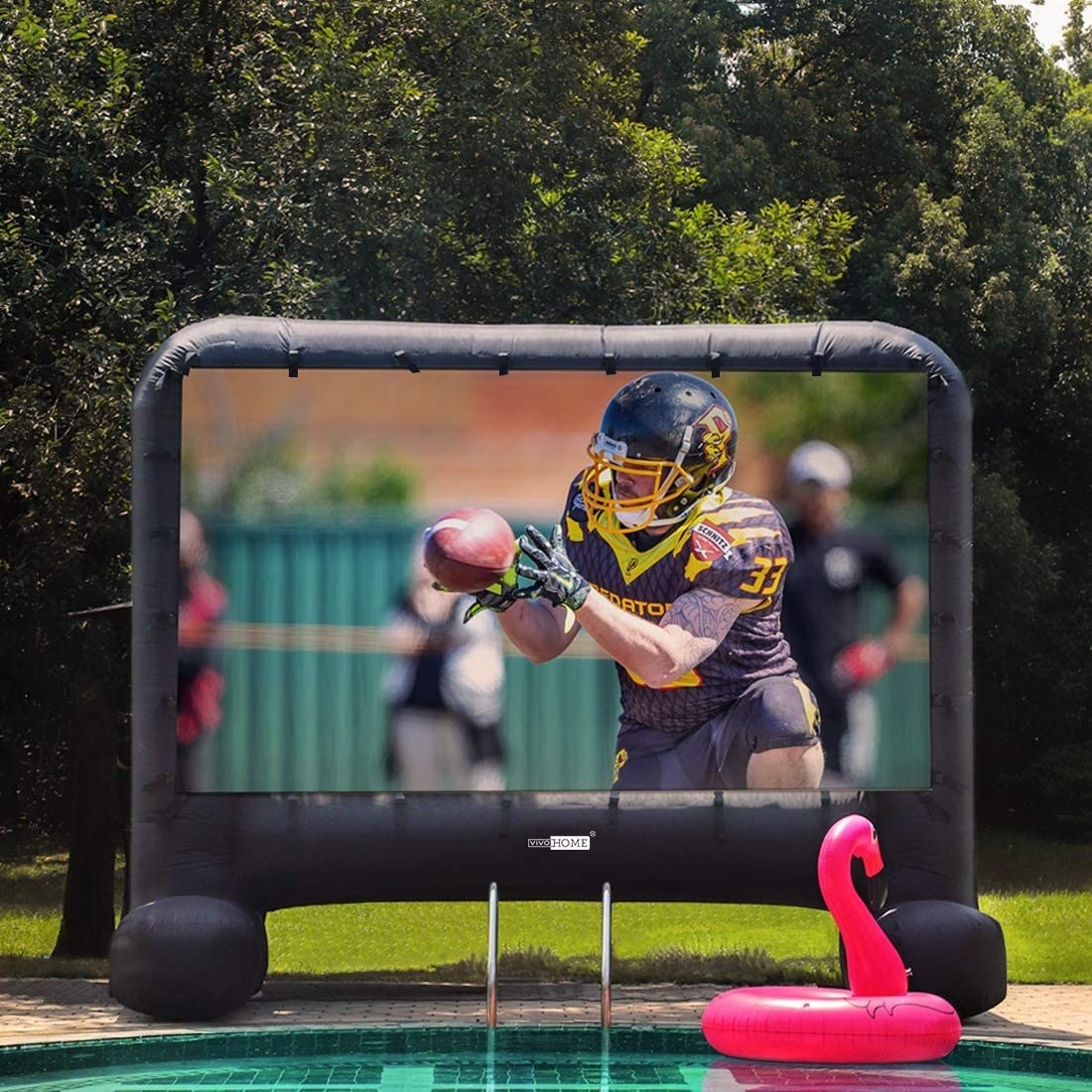 the blow up screen showing a football game