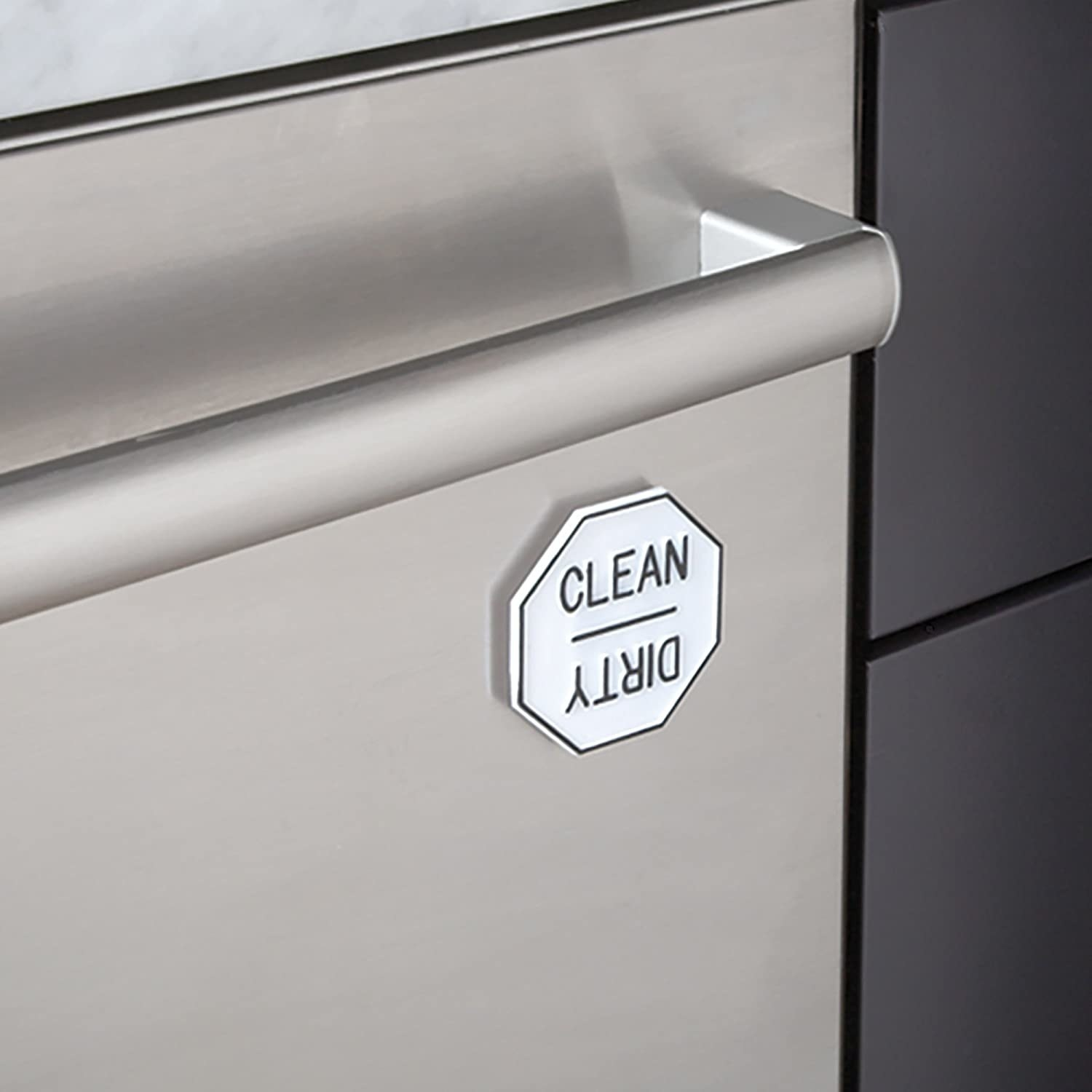 The magnet attached to the dishwasher, indicating that the dishes inside are clean