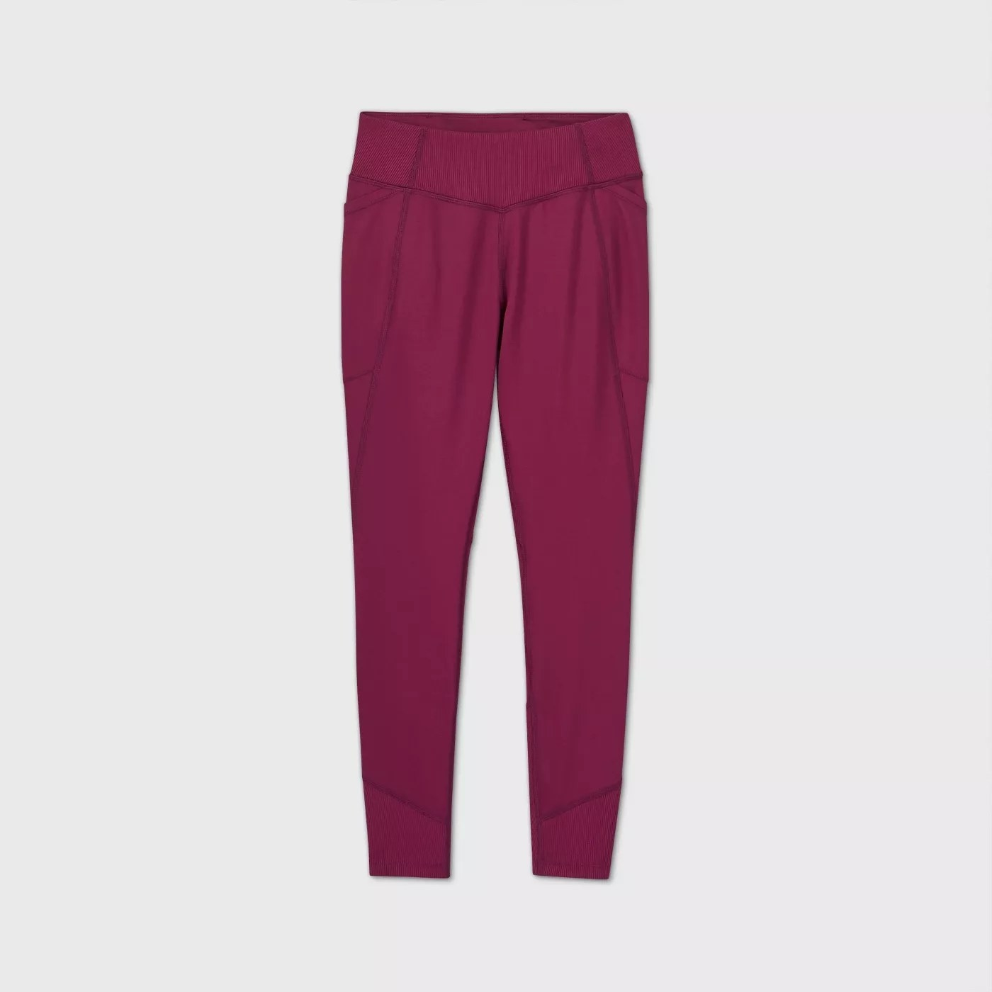 A pair of raspberry purple leggings with pockets