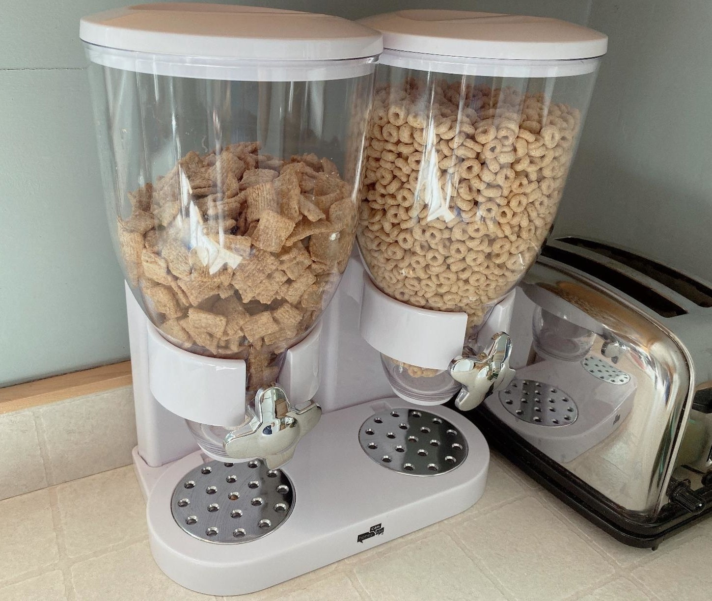 The cereal dispenser holding two kinds of cereal