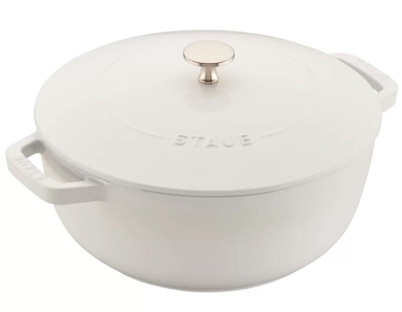 The white cast iron round dutch oven