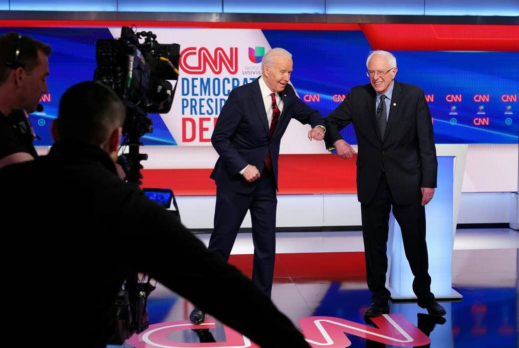 Sanders and Biden bump elbows in greeting