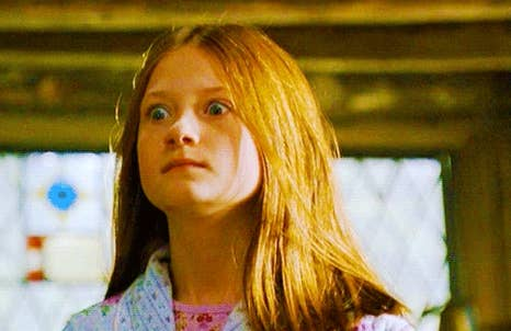 Ginny Weasley staring at Harry Potter in complete shock