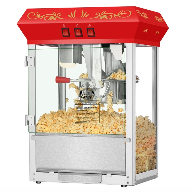 The popcorn machine being used to make fresh popcorn