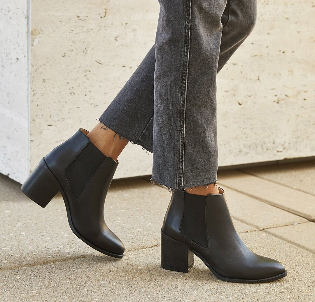 model wearing black ankle booties