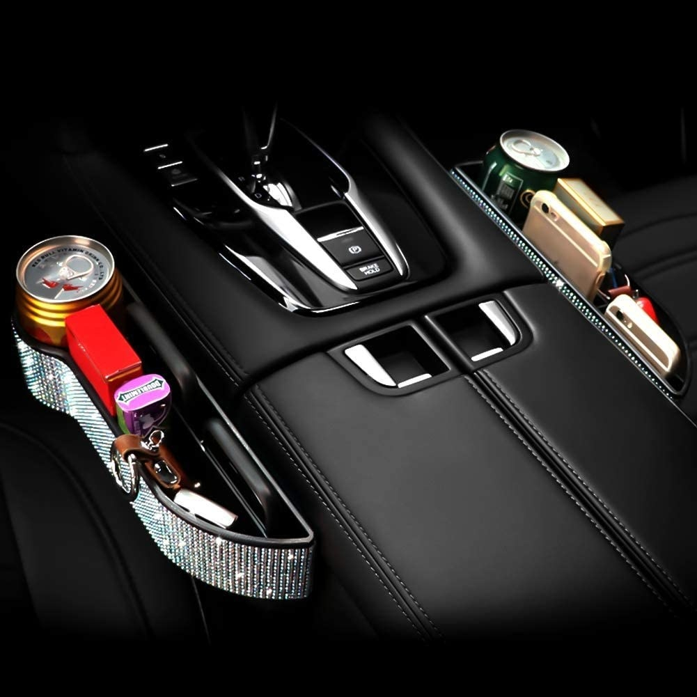 car console with rhinestone covered side organizer attached to it
