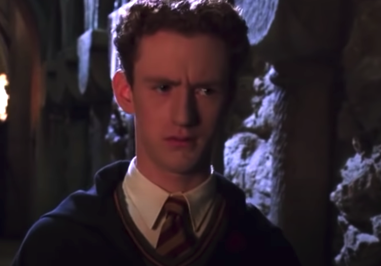 Percy staring at Crabbe and Goyle in the hallway at Hogwarts