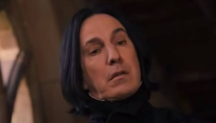 """Snape staring quizzically at Hermione and Ron in one of the earlier """"Harry Potter"""" movies"""
