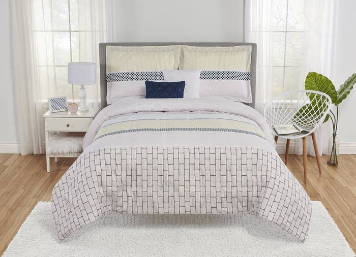 The white patterned duvet cover and pillowcases on a bed