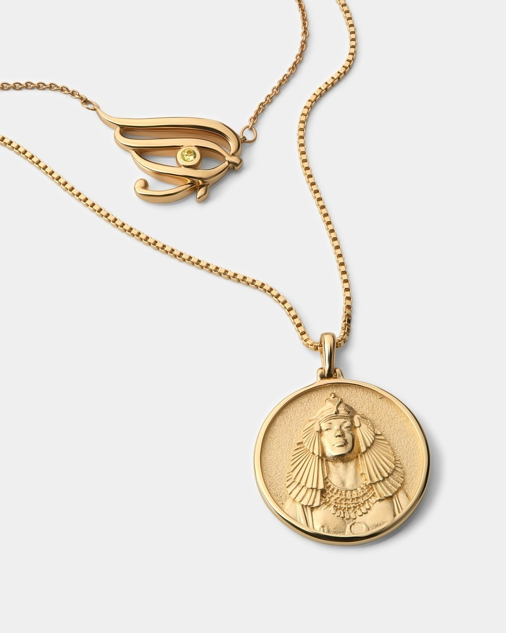 gold necklace with Cleopatra-inspired engraving