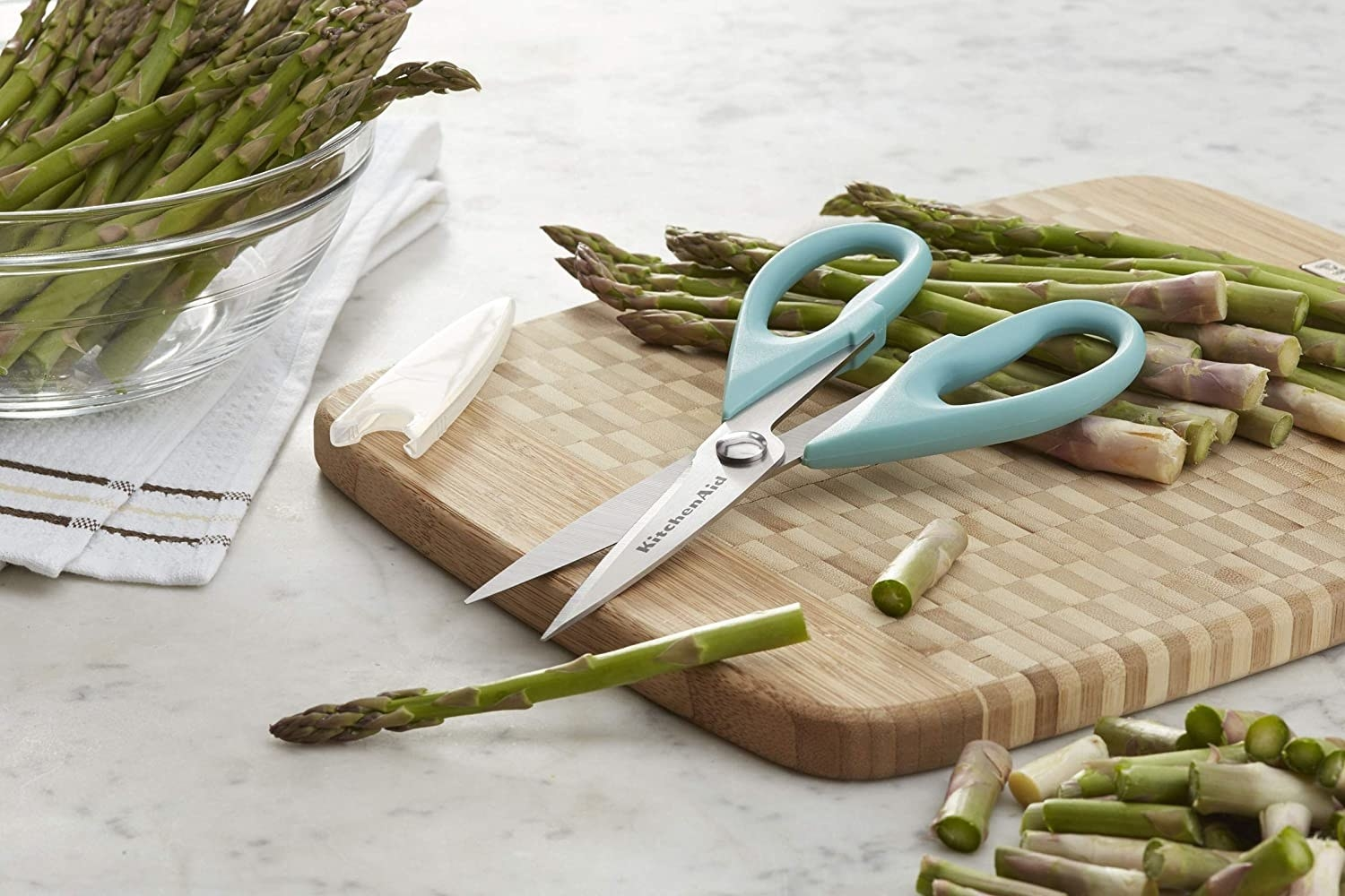The kitchen shears next to some freshly chopped asparagus