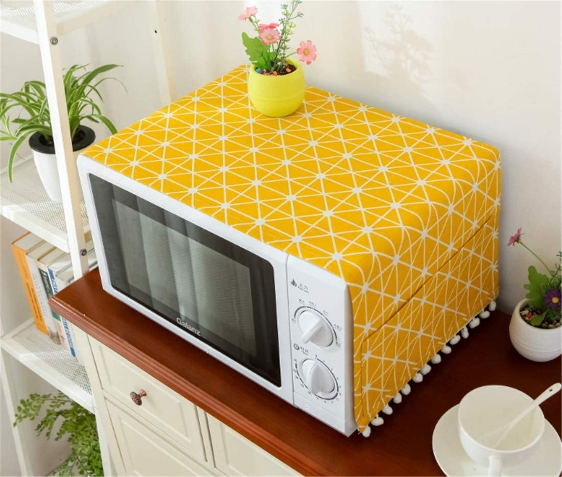 A bright cover on a microwave in a neat kitchen
