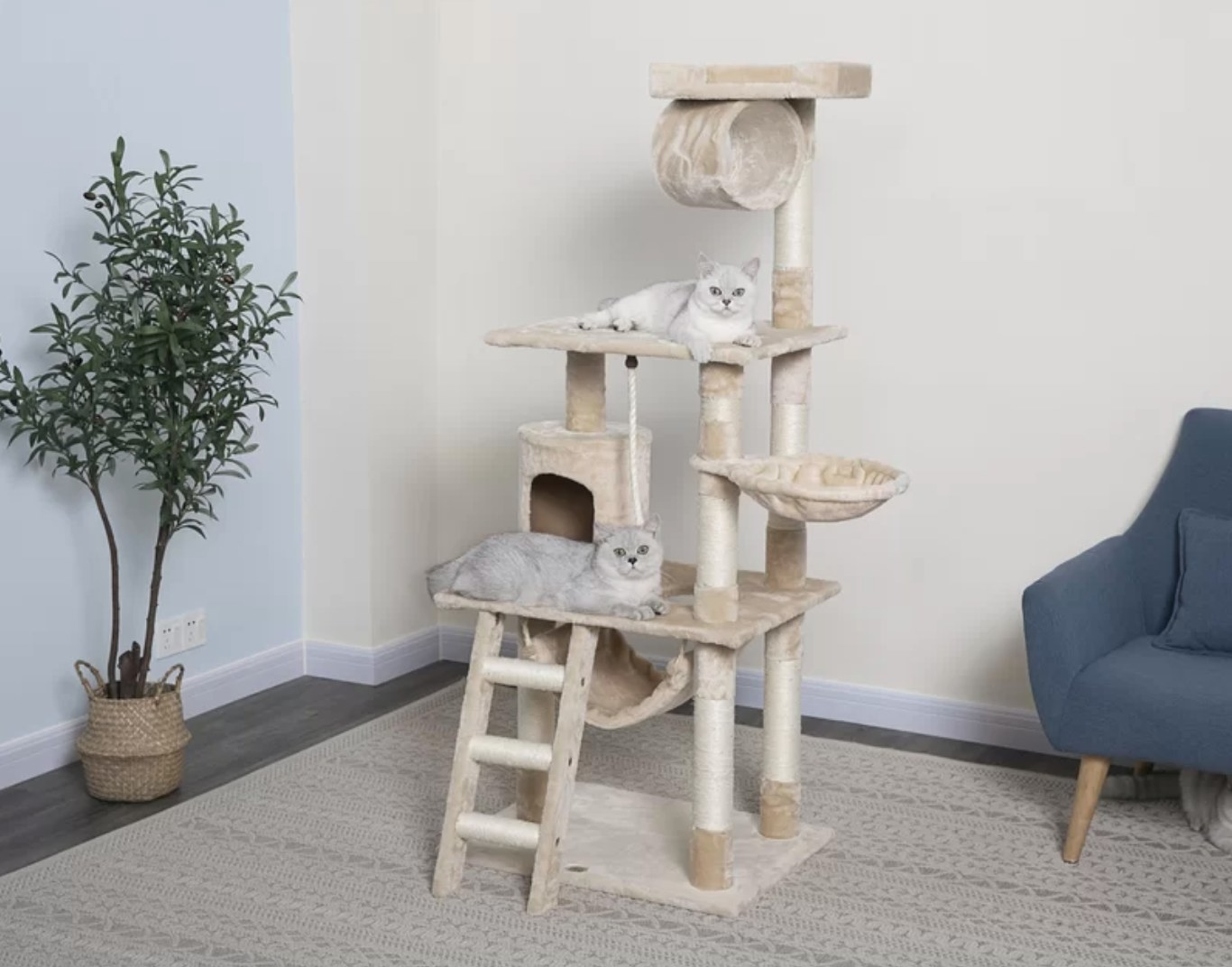 The cat tree in beige with two white cats sitting on it