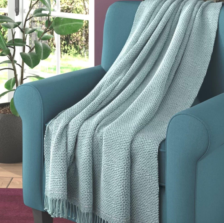 The blue blanket draped across a blue armchair
