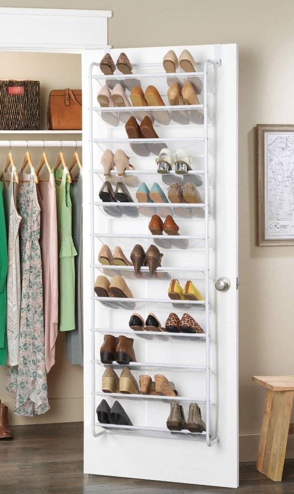 White shoe storage over a closet door