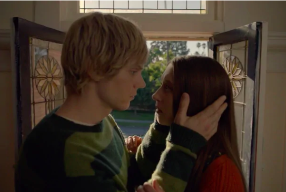 """""""American Horror Story: Murder House"""" character Tate and Violet stare into each other's eyes, while Tate holds her face close"""