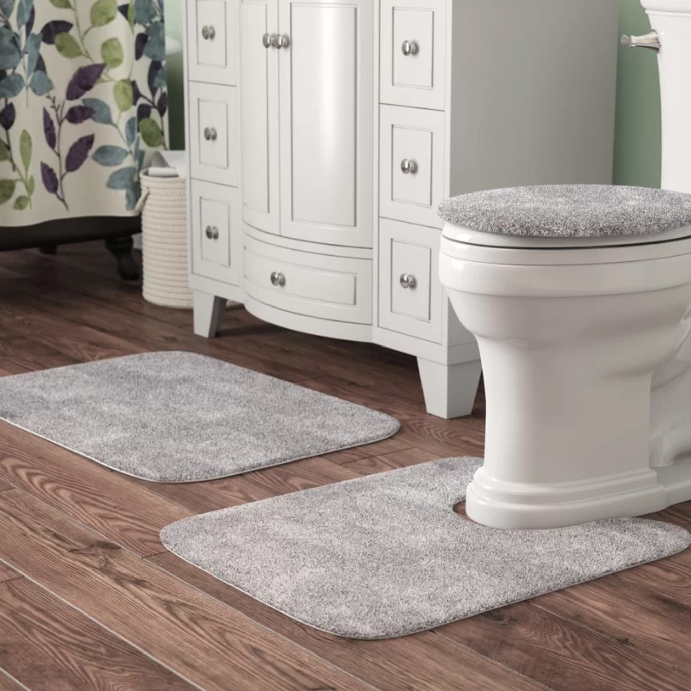 The three-piece set being used as a toilet cover, bathmat, and rug