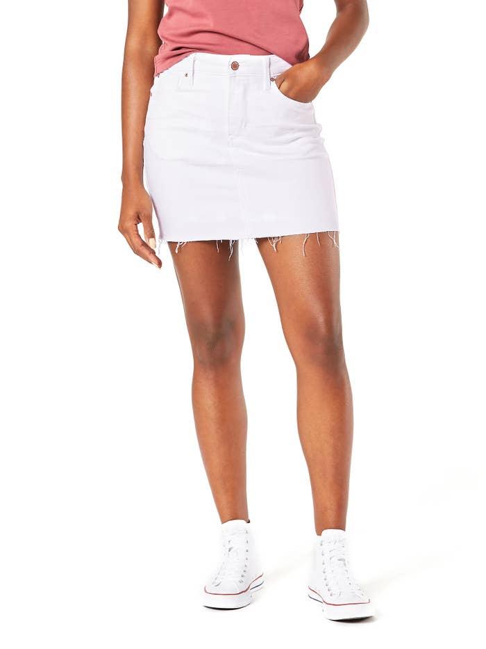 A model wearing the white denim skirt