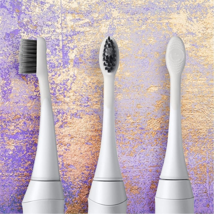 the side and front of the toothbrush's charcoal bristles, and the back of the brush