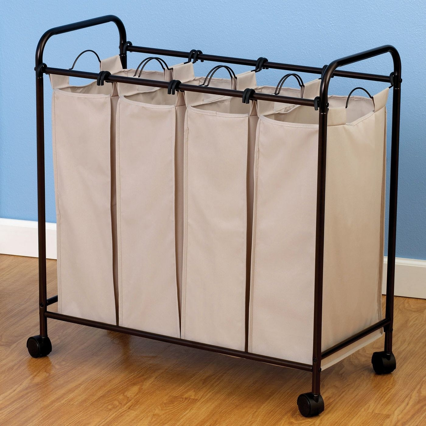 The laundry hamper with four small rectangular bags