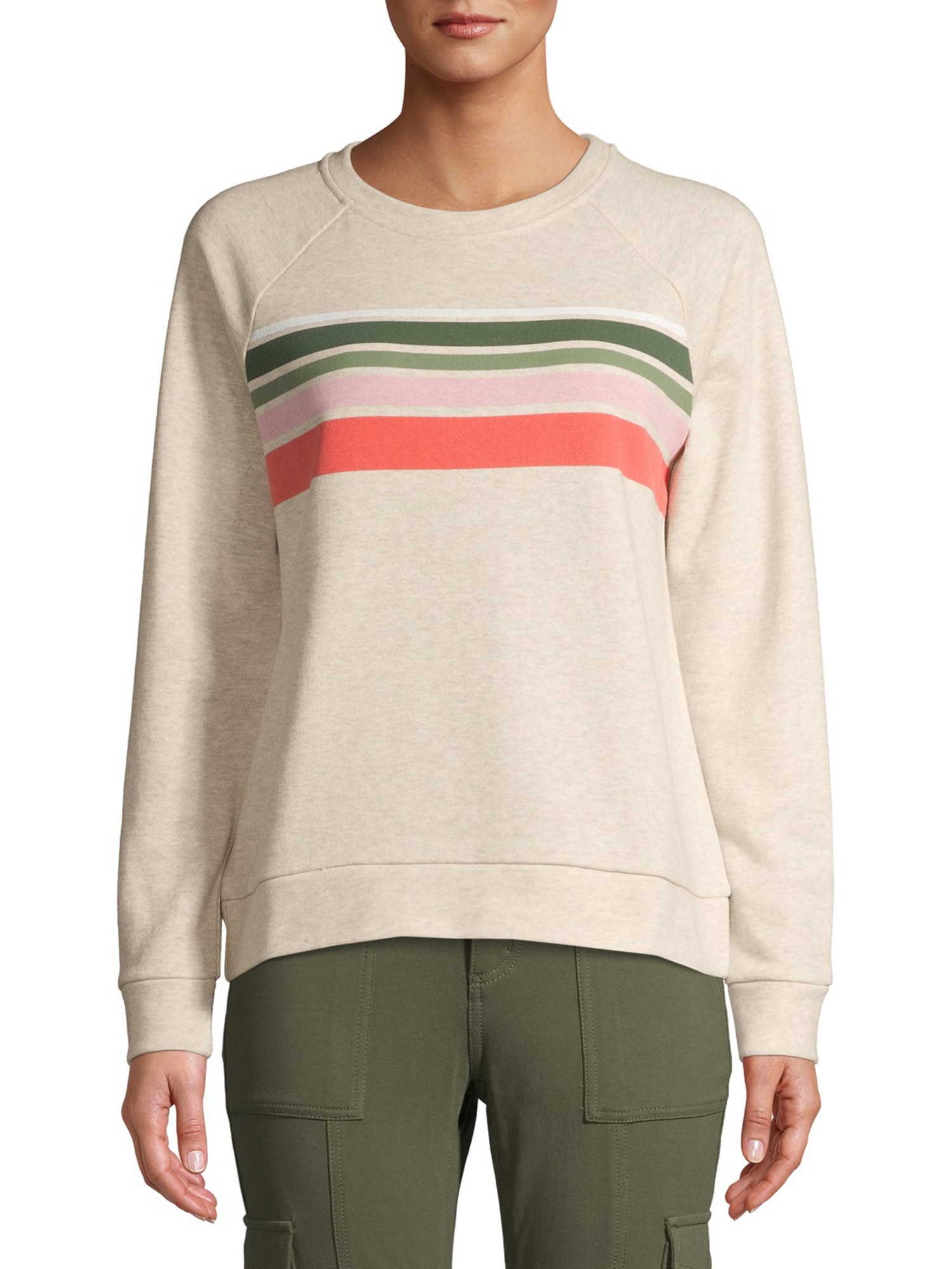 A model wearing the tan sweatshirt with green and pink stripes