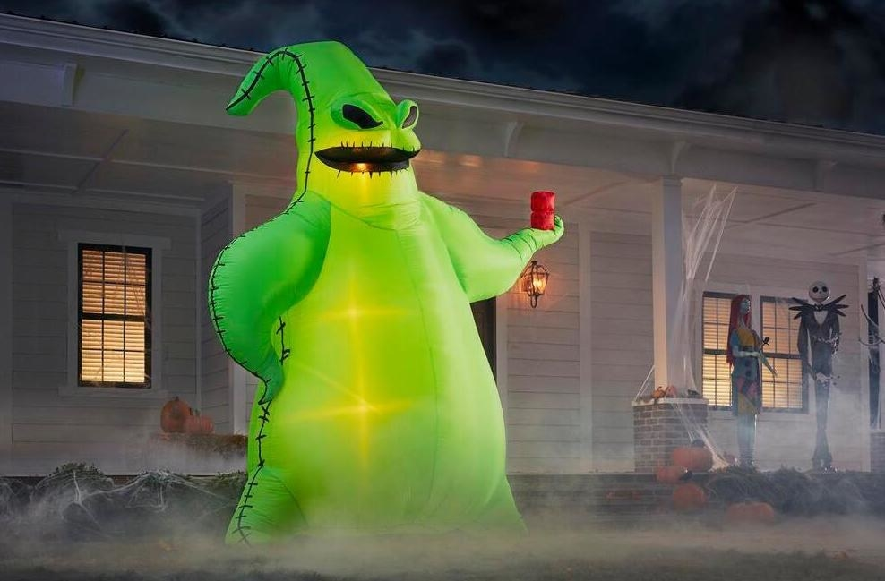 a very tall green, glowing oogie boogie inflatable