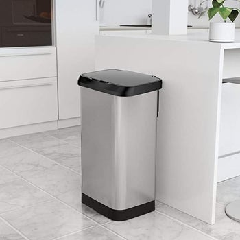 The GLAD Extra Capacity Stainless Steel Sensor Trash Can with Clorox Odor Protection in a kitchen