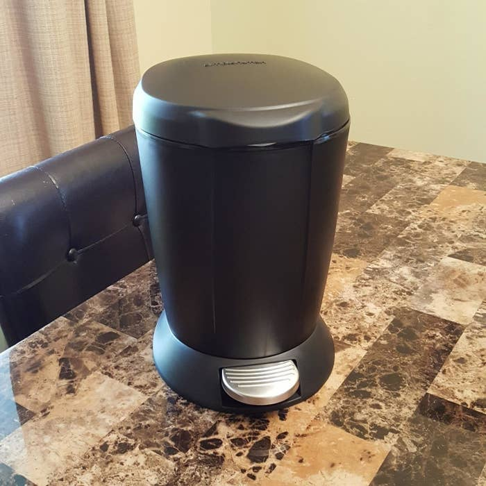 The black simplehuman Mini Round Step Trash Can on a customer's counter