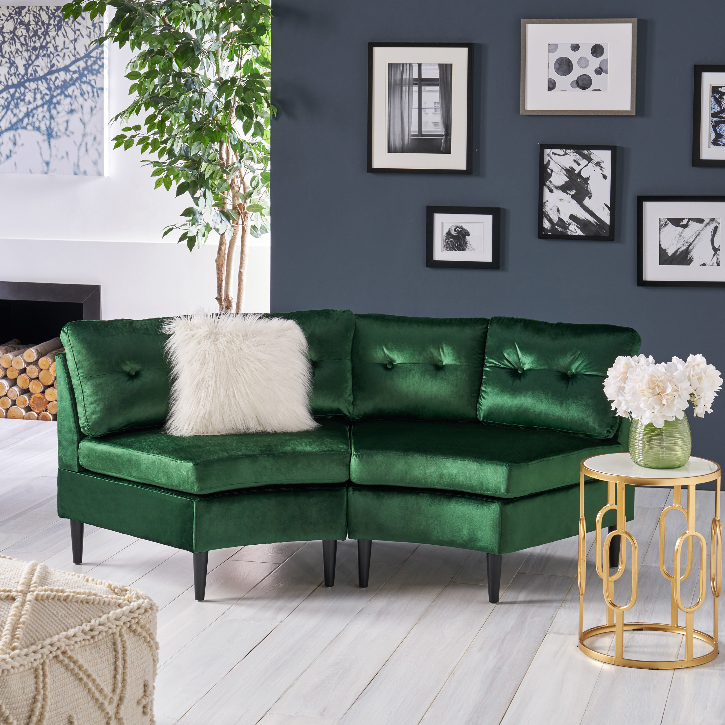 Velvet green modular couch with two seats and black legs