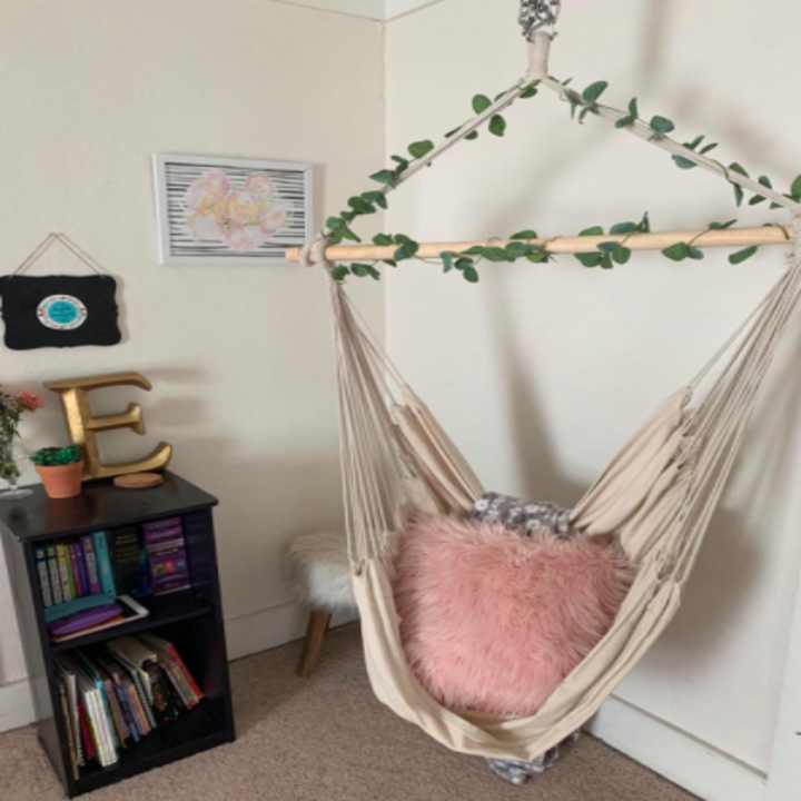Reviewer uses same hammock laced with fake vines to create a cozy corner indoors