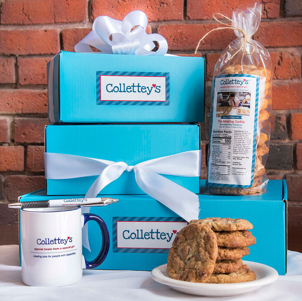 Packaging with ribbon, cookies, pen, and mug