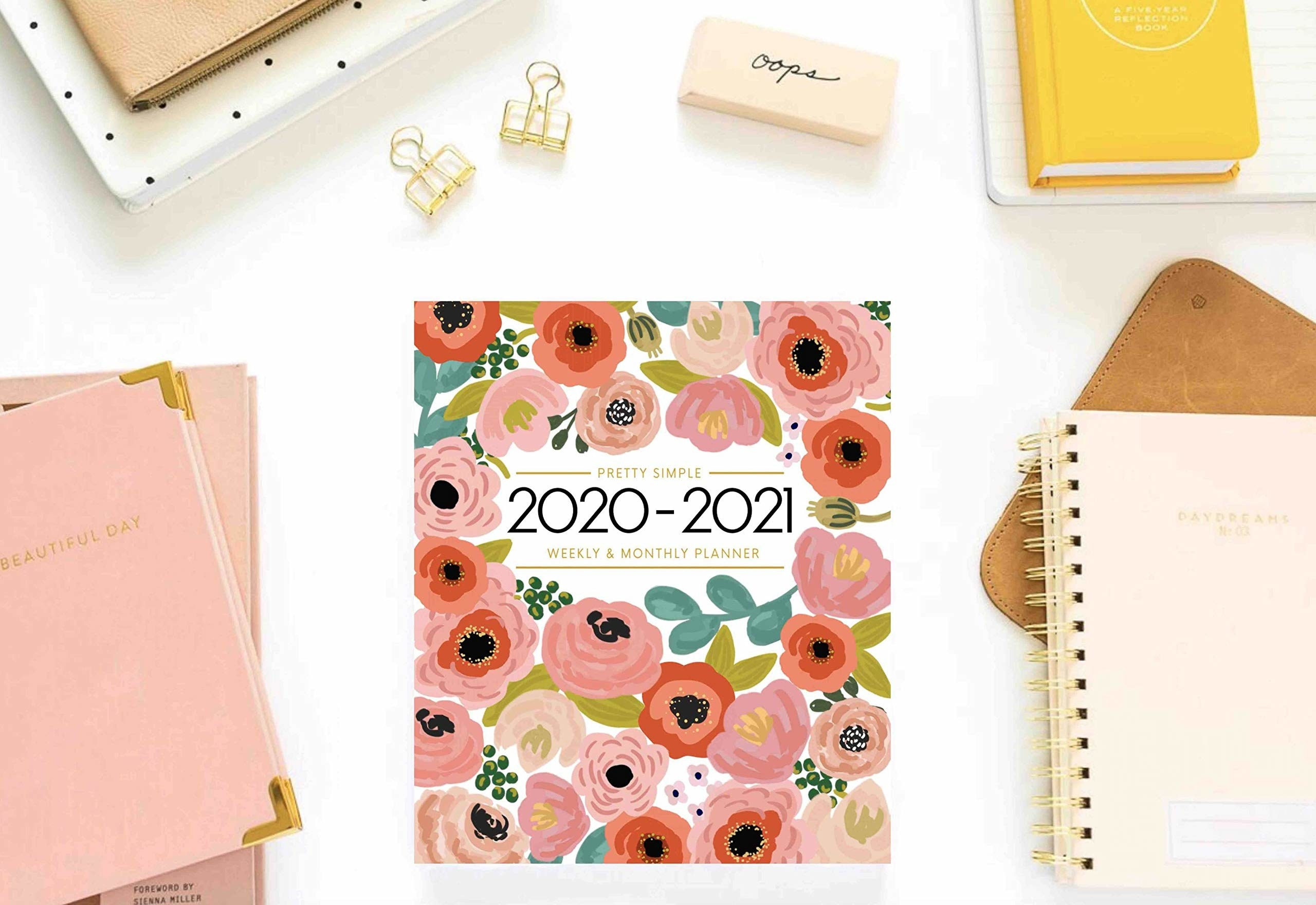 A floral planner that says 2020 and 2021