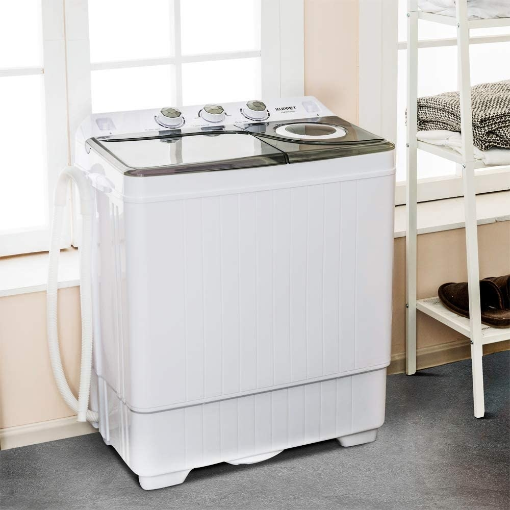 The hite mini portable washing machine with a grey lid