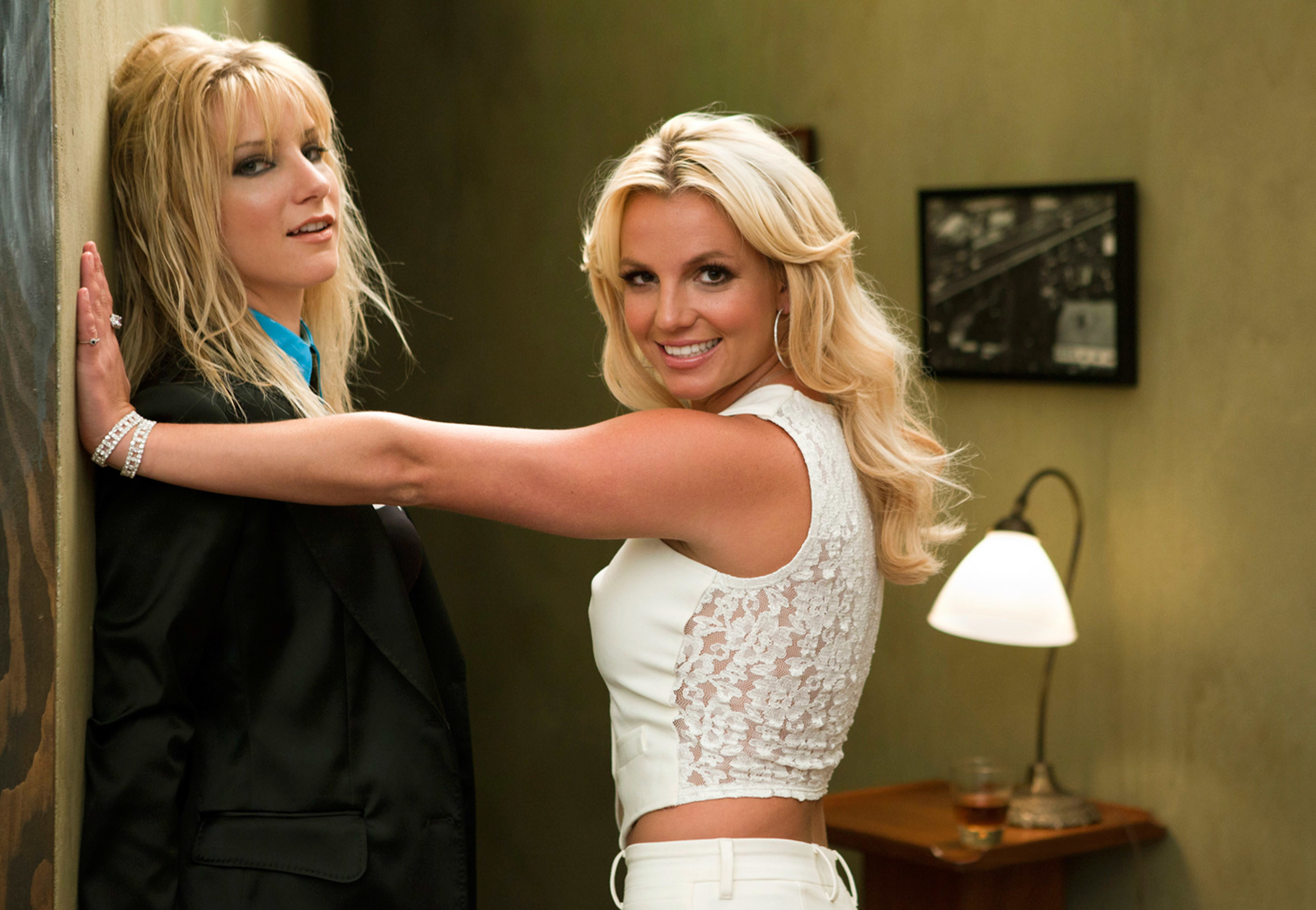 "A photo of Heather Morris and Britney Spears recreating the almost kiss between her and Madonna from the ""Me Against the Music"" music video"
