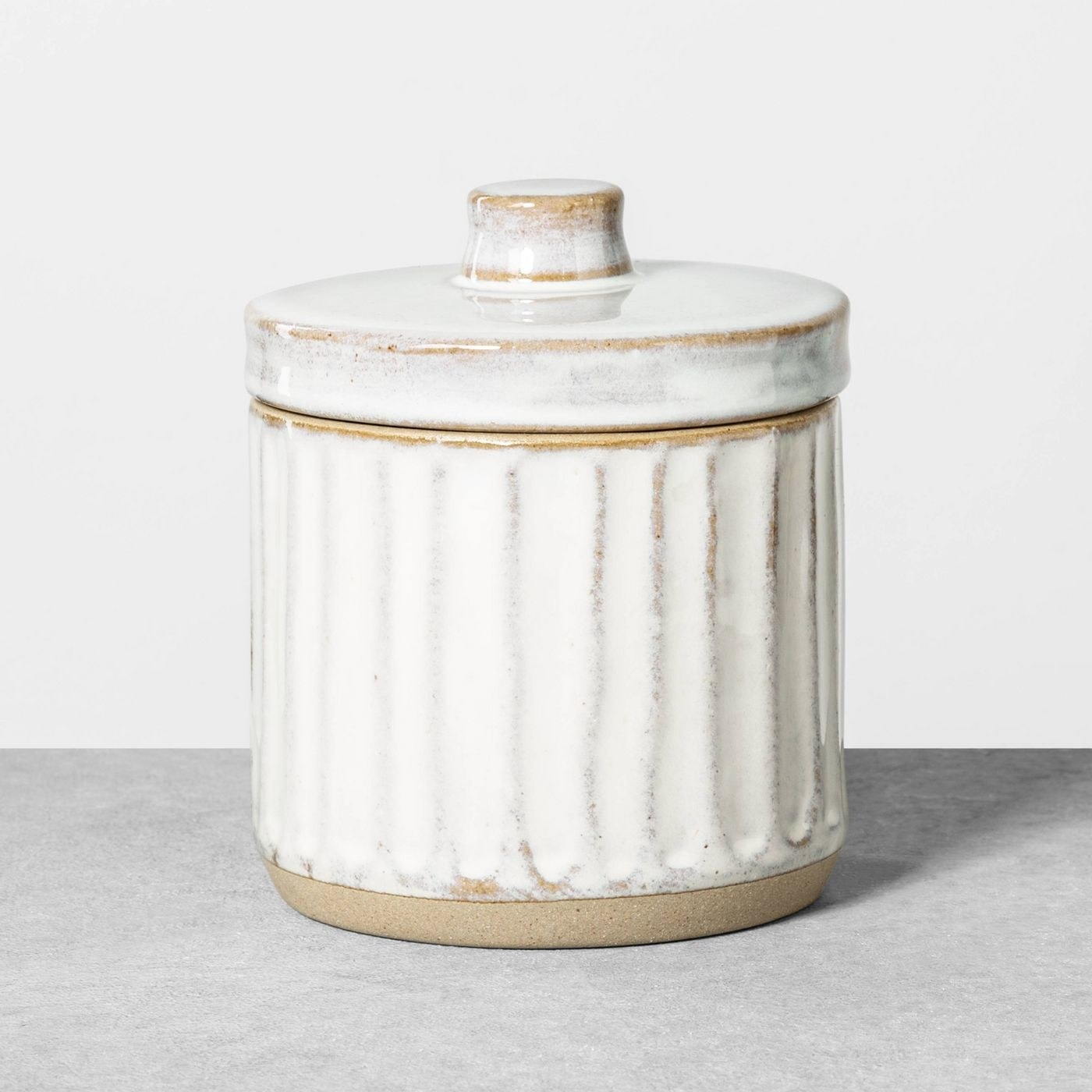 The cream and tan embossed canister