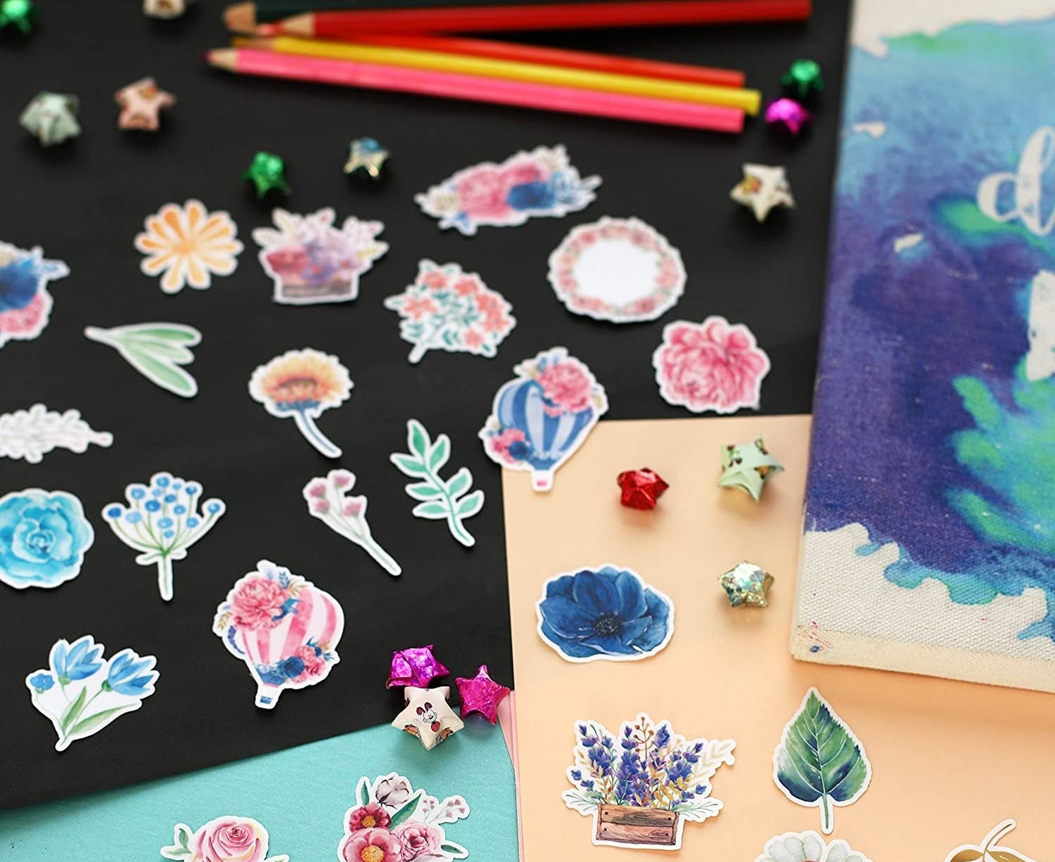 A variety of floral stickers spread on a table