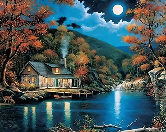 Picture of a moonlit cabin,