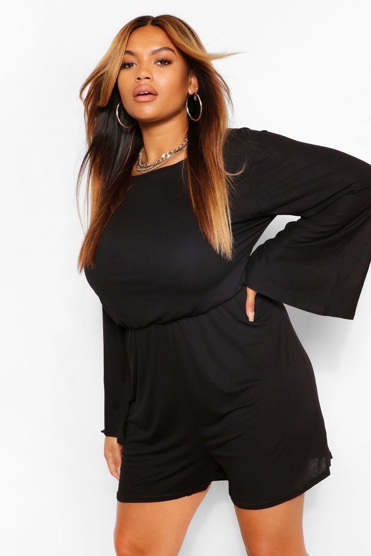 Model in the black wide-sleeve romper with elastic waist